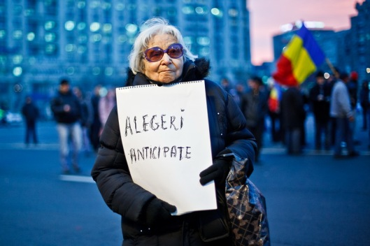 An old lady who participated at the USL protest on the Kisseleff Boulevard, holding a panel with 'Early elections' written on it she protest in front of the government building, after she managed to enter along with other protesters in University Square, from Bucharest, Romania, Thursday 19 January 2012. Ovidiu Micsik / MEDIAFAX FOTO