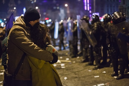 Two young lovers in front of the police forces cord, protest in Union Square, Bucharest, Romania, Thursday 19 January 2012. Ovidiu Micsik / Inquam Photos